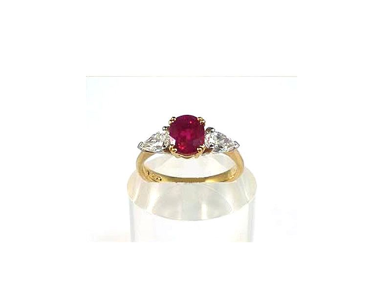 18CT GOLD & PLATINUM, 1.40CT OVAL RUBY & .65CTS PEAR SHAPED DIAMOND, THREE STONE RING