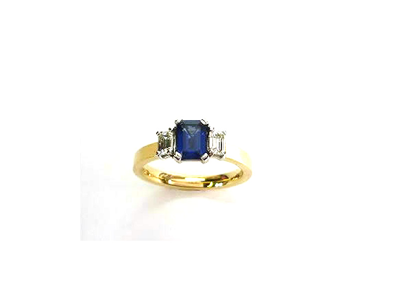 18CT YELLOW & WHITE GOLD, 7x5mm 1.18CT OCTAGONAL KANCH SAPPHIRE & .50CTS  EMERALD CUT DIAMOND RING.