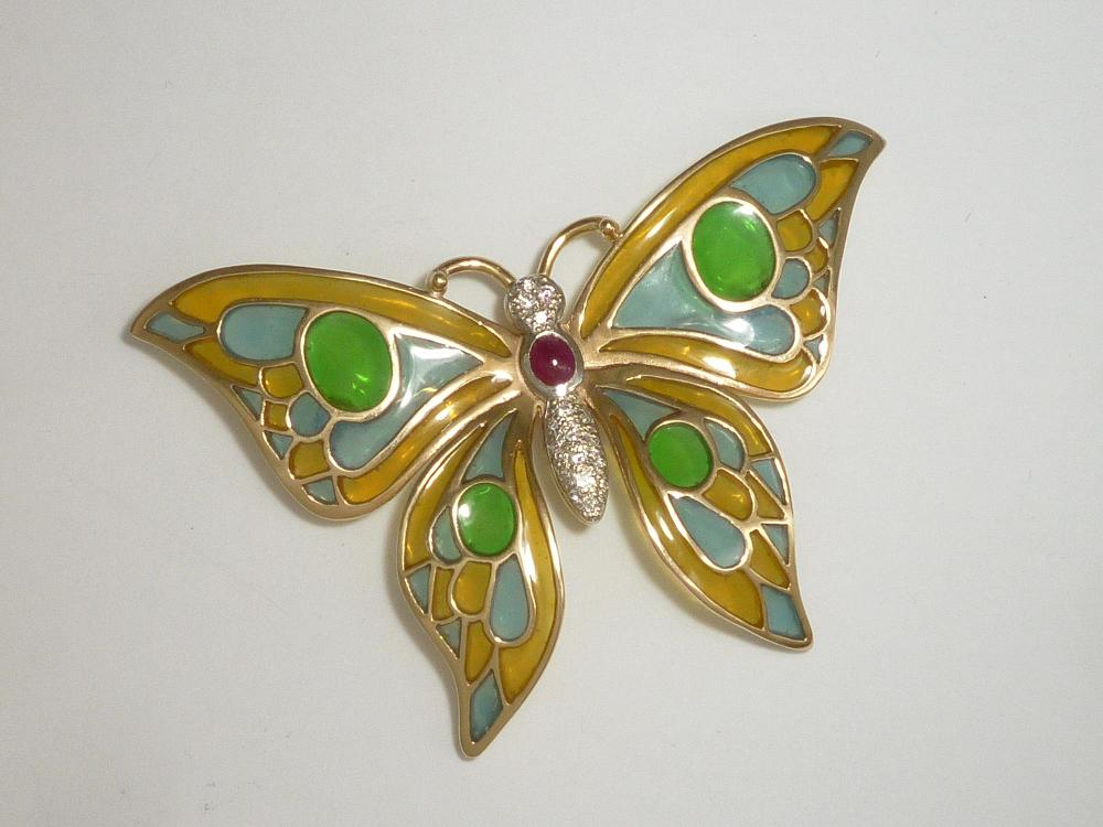 YELLOW AND WHITE GOLD, COBOUCHON RUBY AND ROUND DIAMOND SET, ENAMELLED BUTTERFLY BROOCH