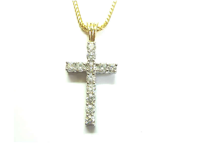(2.2) 18CT WHITE AND YELLOW GOLD, DIAMOND CLAW SET, CROSS PENDANT (2)