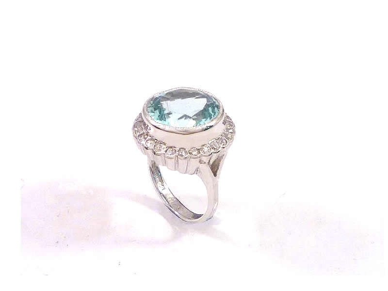 (4.2) 18CT WHITE GOLD, AQUA MARINE AND DIAMOND RING (2)