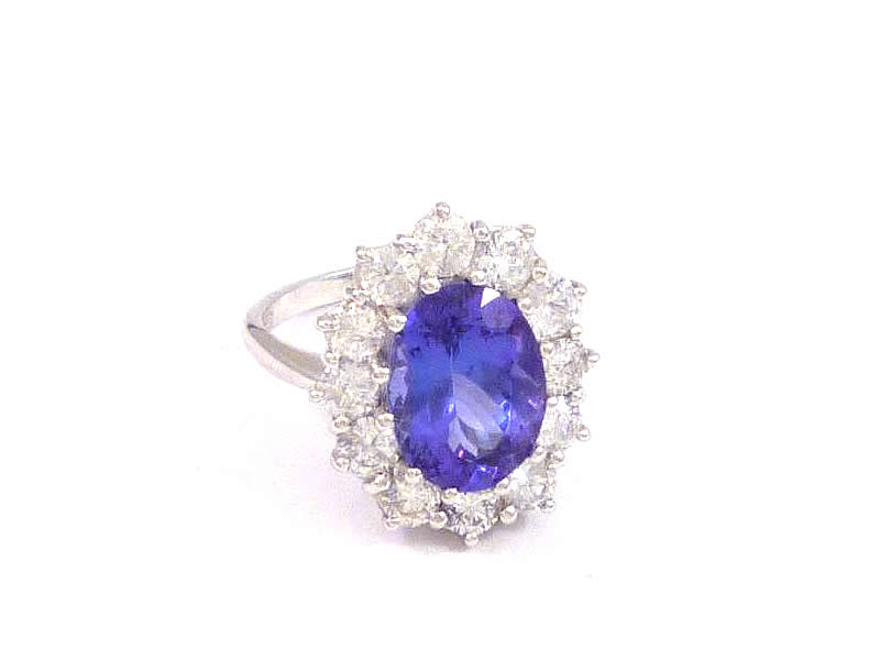 (5.2) 18CT WHITE GOLD, TANZANITE AND DIAMOND CLUSTER RING 1